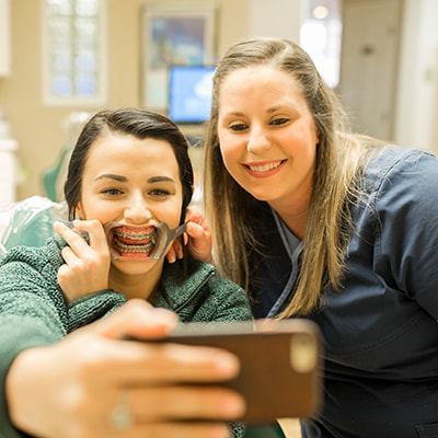 Alisha - orthodontic assistant- taking a selfie with a patient