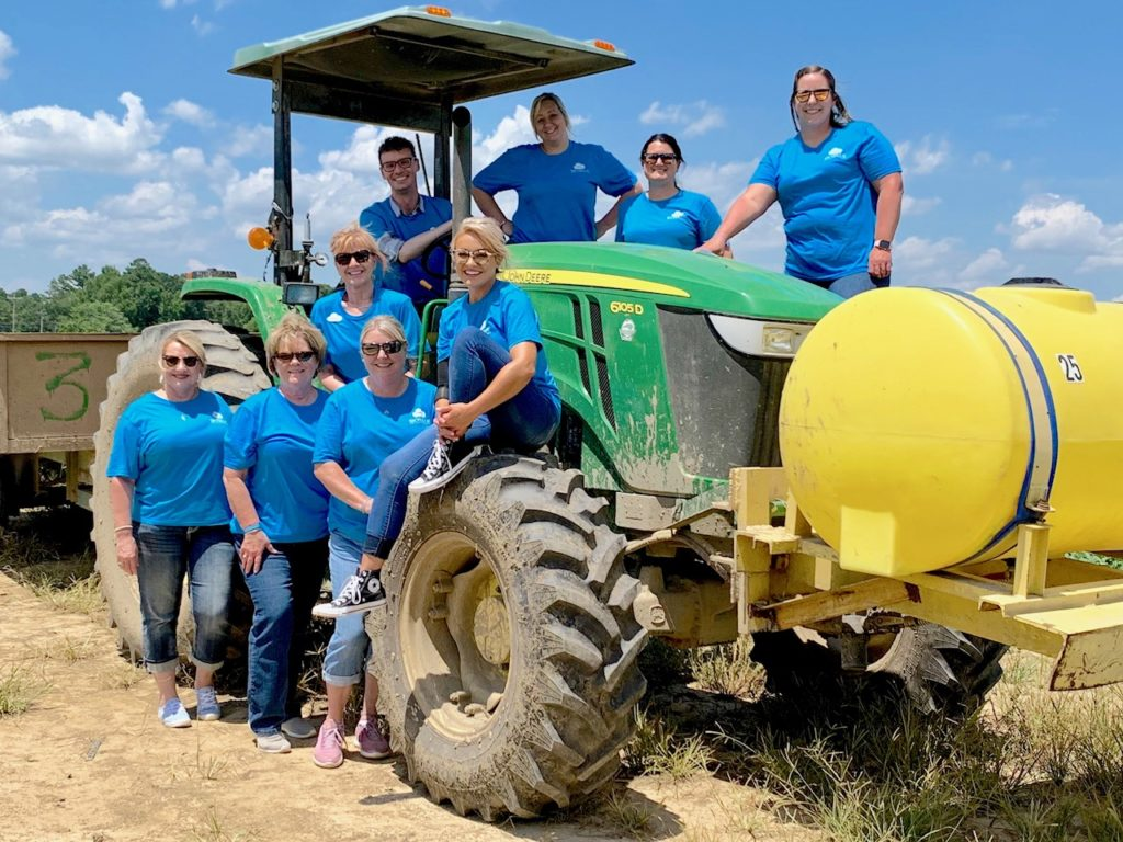 Skyblue Orthodontics team farming tractor