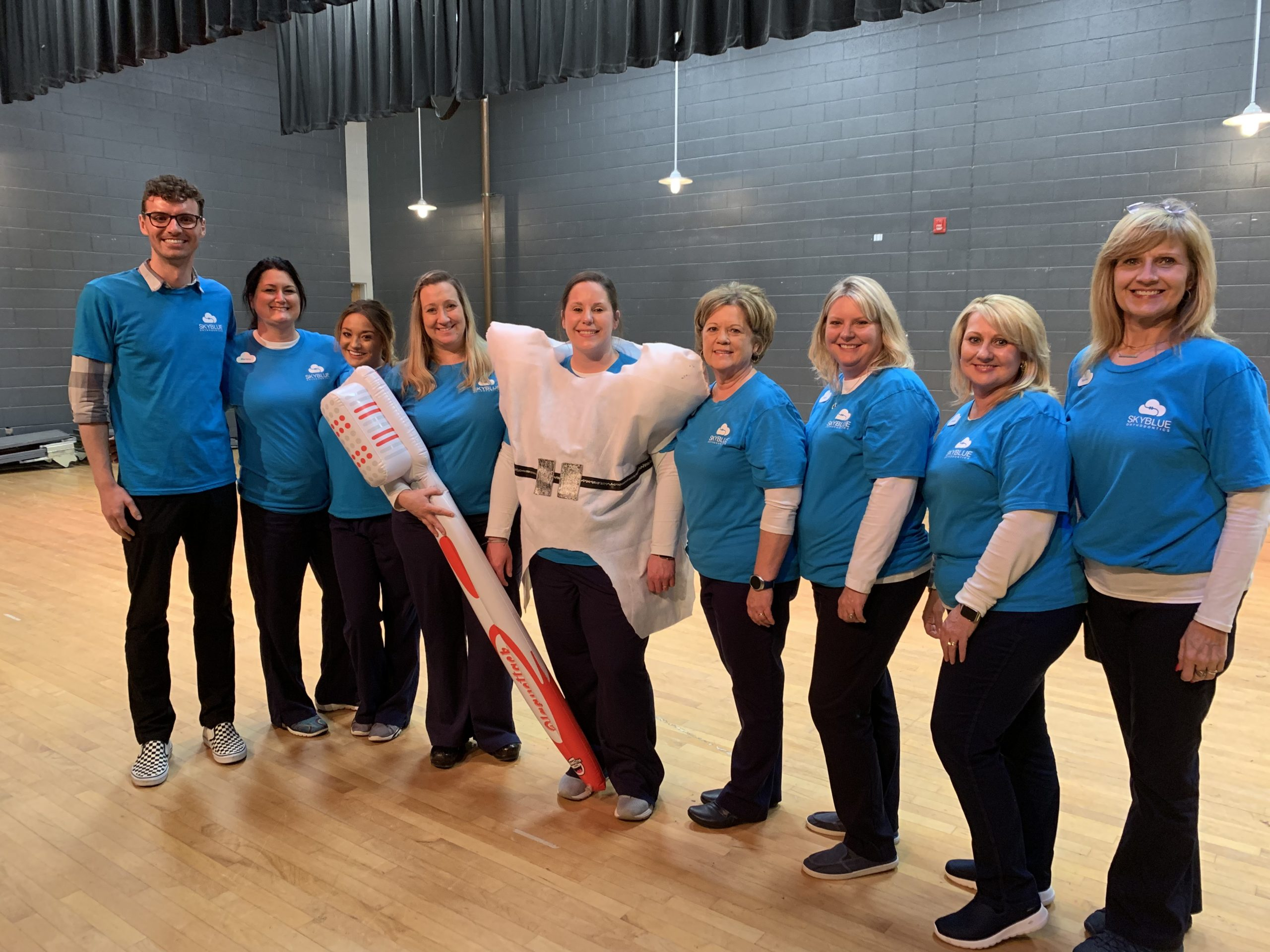 Skyblue Orthodontics team brush and floss demonstration at Coats Erwin Middle School
