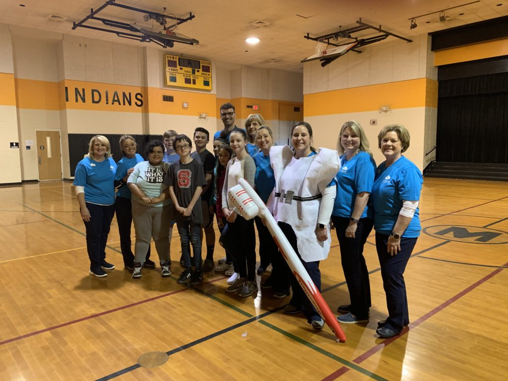 Skyblue team orthodontic education and oral hygiene instruction at middle school
